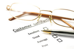 Customer satisfaction survey form with the pen and glasses Stock Images