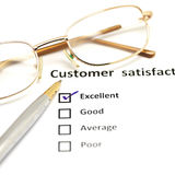 Customer satisfaction survey form with the pen and glasses Royalty Free Stock Photos