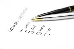 Customer satisfaction survey form with the pen Royalty Free Stock Photos