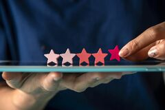 Customer satisfaction survey, give 5 star rating for review, positive feedback good experience, woman holding five star on tablet