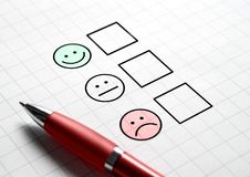 Customer satisfaction survey and questionnaire concept. Giving feedback with multiple choice form. Pen, paper and emotion smiley face icons Stock Photography