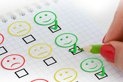 Customer satisfaction survey or questionnaire. With smiley faces Royalty Free Stock Photos
