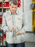 Customer Scanning Tool Packet Through Cellphone Stock Photos