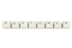 Customer from scattered keyboard keys on white Stock Photo