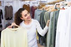 Customer selecting basic garments Royalty Free Stock Photo