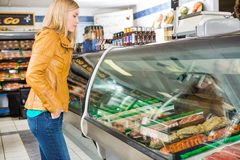 Customer Selecting Meat At Butcher's Shop Stock Photography