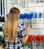 Customer Selecting Screwdriver In Hardware Shop Stock Photos