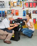 Customer Selecting Tools While Salesman Assisting Stock Photography