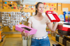 Customer selects bright  boxes  for gifts Stock Images