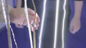 The customer selects the LED ribbon. Shop of lighting equipment. Modern lamps stock video