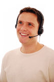 Customer service. Friendly male call centre operator on the phone isolated on white Royalty Free Stock Images