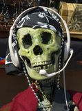 Customer service. Pirate skeleton with customer service headset and clothes Stock Photos
