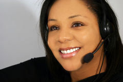 Customer service. Young woman with headphones - customer service assisatnt in call center stock photos