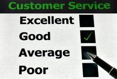 Customer service. Black pen tick the good customer service stock photos
