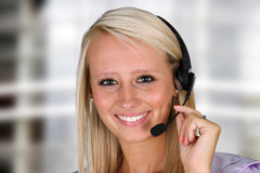 Customer Service. Young woman giving help as a customer service employee Royalty Free Stock Images