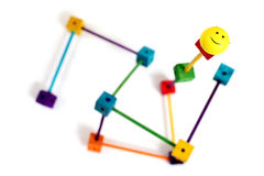 Customer service. Smiley face on building blocks and sticks representing the keys to good customer service stock images