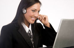 Customer Service Employee on Computer Headset  Stock Photography
