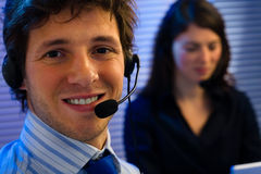 Customer Service. Male and female customer service representative working in office, smiling Stock Photo