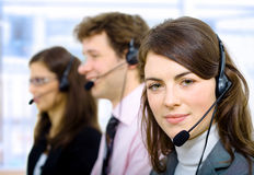 Customer Service. Team working in headsets, smiling Royalty Free Stock Images