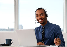 Customer Service. Agent in an office with laptop Royalty Free Stock Photo