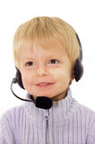Customer Service. Baby boy wearing headphones representing customer service Royalty Free Stock Images