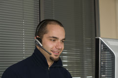 Customer Service. A Customer service Representative on a wireless phone Stock Photo