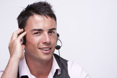 Customer service. Young, handsome,smiling customer service operator Stock Images