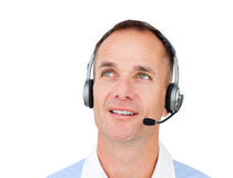 Customer service agent. Attractive Customer service agent talking on headset against a white background Stock Image
