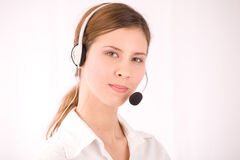 CUSTOMER SERVICE AGENT. Happy young and beautiful businesswoman Royalty Free Stock Image