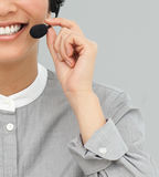 Customer service agent with headset on smiling Royalty Free Stock Photography