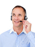 Customer service agent looking upward. Customer service agent with headset on looking upward against a white background Royalty Free Stock Image