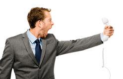Customer service agent shouting phone white background Stock Image