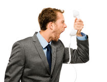 Customer service agent shouting phone white background. Unhappy Business man shouting screaming at phone Stock Images