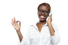 Customer service agent showing okay gesture. Young customer service agent showing okay gesture to camera Royalty Free Stock Images