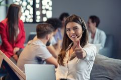 Customer Service agent in an startup office with laptop royalty free stock photography