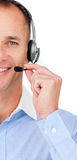 Customer service agent talking on headset. Close-up of a mature Customer service agent talking on headset against a white background Stock Image