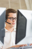 Customer service agent using computer Stock Image