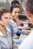 Customer Service Agents Looking At Manager Stock Image