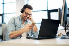 Customer service agents working in office Royalty Free Stock Photo