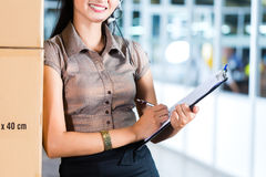 Customer Service in Asian logistics warehouse Stock Photography