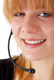 Customer service assistant. Beautiful young customer service assistant with headset (on white Stock Photo