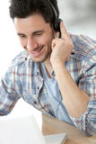 Customer service assistant talking to client Royalty Free Stock Photo
