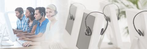 Customer service assistants with headsets with bright computer background. Digital composite of Customer service assistants with headsets with bright computer royalty free stock photography