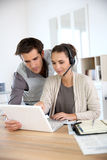 Customer service assistants searching for solutions Royalty Free Stock Photography