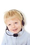 Customer Service Baby. A cute toddler wearing a customer service headset and a happy smile Royalty Free Stock Photo