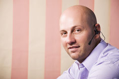 Customer service bald man Stock Photo