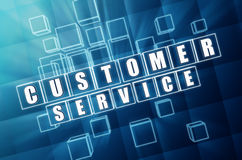 Customer service in blue glass cubes. Customer service - text in 3d blue glass cubes with white letters, business concept Royalty Free Stock Photo