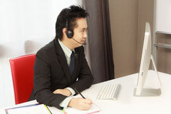 Customer Service. Business Man With Headset Service Customer In A Call Centre Stock Image