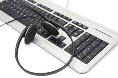 Customer service concept with keyboard and headset Royalty Free Stock Photos