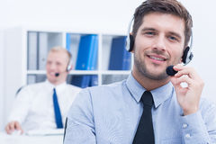 Customer service consultant wearing headset. Portrait of handsome customer service consultant wearing headset Stock Photo